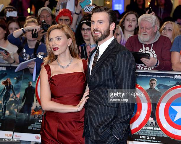 """Scarlett Johansson and Chris Evans attend the UK Film Premiere of """"Captain America: The Winter Soldier"""" at Westfield London on March 20, 2014 in..."""