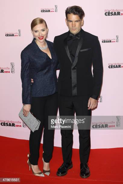 Scarlett Johansson and Romain Dauriac arrive for the 39th Cesar Film Awards 2014 at Theatre du Chatelet on February 28 2014 in Paris France