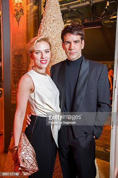 Scarlett Johansson and Romain Dauriac attend the Yummy Pop Grand Opening Party at Theatre du Gymnase on December 16 2016 in Paris France