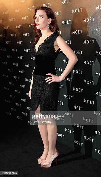 Scarlett Johansson arrives for the Moet and Chandon A Tribute to Cinema party at Big Sky Studios on March 24 2009 in London England