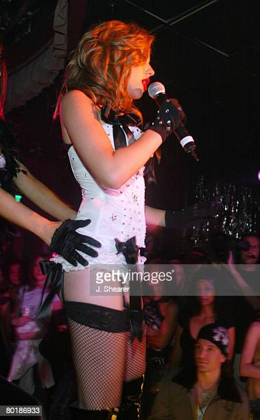 Scarlett Johansson performs with The Pussycat Dolls