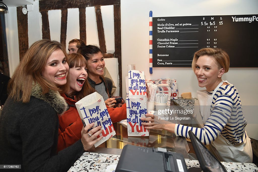 Scarlett Johansson serves patrons during the opening of the Yummy Pop shop where Scarlett Johansson opens the new store Yummy Pop in Le Marais, Paris on October 22, 2016 in Paris, France.