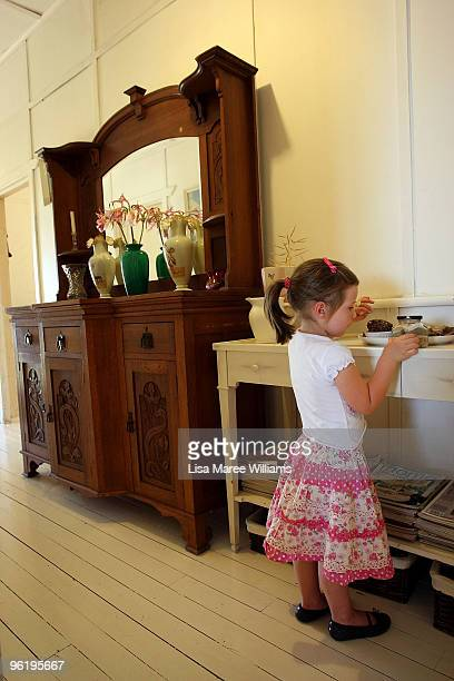 Scarlett Mercer plays in the hallway of her country home called 'Barina' which is part of the Rentafarmhouse scheme where families can rent a...