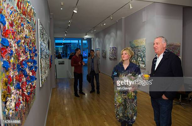 Scarlett Raven and Micheal Barrymore attend the private view of 'Flight' by artist Scarlett Raven at the Hay Hill Gallery on April 10 2012 in London...