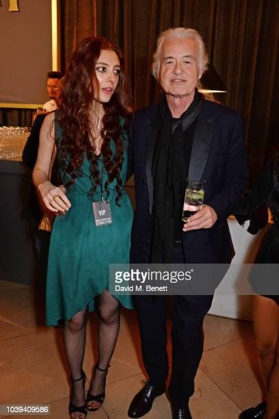 Scarlett Sabet and Jimmy Page attend the launch of Led Zeppelin by Led Zeppelin the official illustrated book marking the 50th anniversary of their...