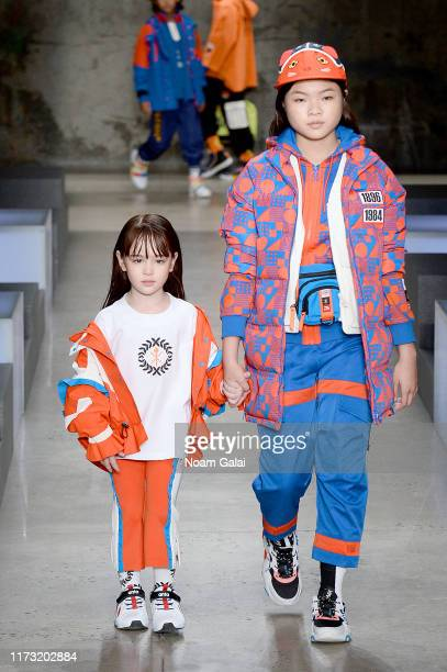 Scarlett Sher and Miya Cech and models walk the runway for China Day: Anta Kids during New York Fashion Week: The Shows on September 08, 2019 in New...