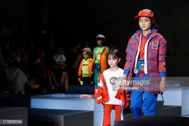 Scarlett Sher and Miya Cech and models walk the runway for the China Day: Anta Kids front row during New York Fashion Week: The Shows on September...