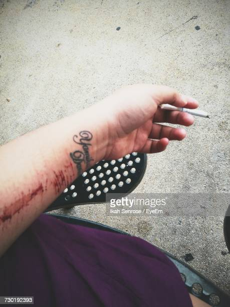 Scars On Hand Holding Cigarette
