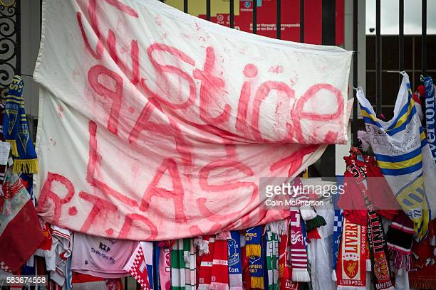 Scarves and a banner attached to the Shankly Gates at Anfield part of the memorial to the 1989 Hillsborough stadium disaster where 96 Liverpool...