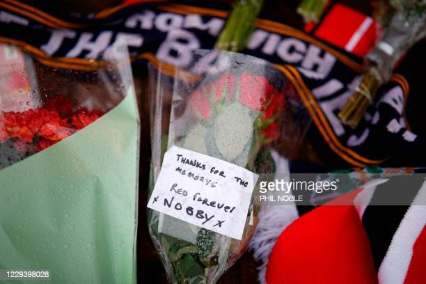 Scarves and flowers are left in honour of the late Manchester United and England midfielder Nobby Stiles outside Old Trafford in Manchester, north...