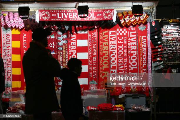 Scarves and memorabilia for sale outside Anfield ahead of the UEFA Champions League round of 16 second leg match between Liverpool FC and Atletico...