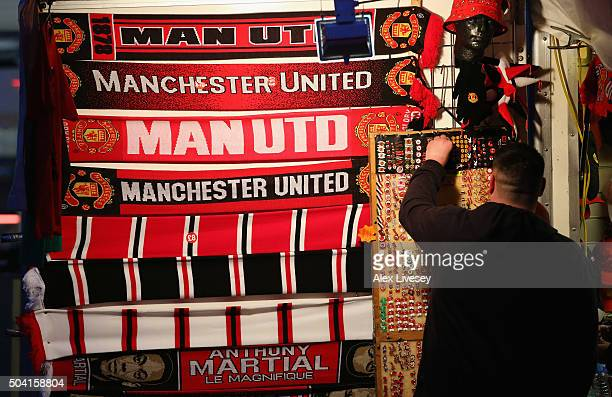 Scarves are seen for sale outside Old Trafford prior to the Emirates FA Cup Third Round match between Manchester United and Sheffield United at Old...