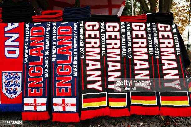 Scarves are seen for sale outside the ground before the International Friendly between England Women and Germany Women at Wembley Stadium on November...