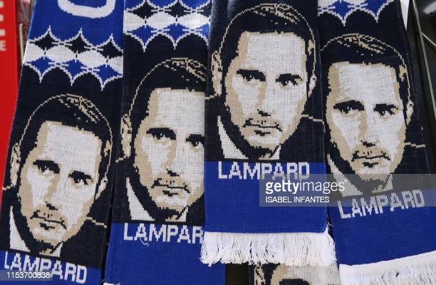 Scarves featuring the image of Chelsea's newly appointed English head coach Frank Lampard are pictured ahead of his unveiling press conference at...