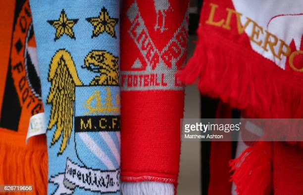 Scarves hang on the Shankly Gates alongside the Hillsborough memorial outside Anfield stadium the home of Liverpool Football Club