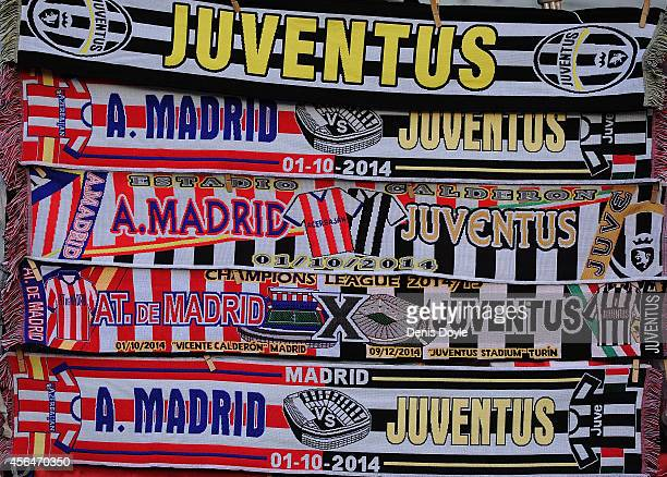 Scarves of Club Atletico de Madrid and Juventus are displayed ata stall outside the Vicente Calderon Stadium before the UEFA Champions League Group A...