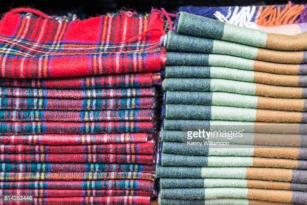 Scarves piled up for sale outdoors