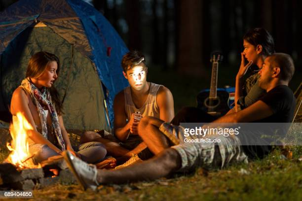 scary campfire stories - storyteller stock pictures, royalty-free photos & images