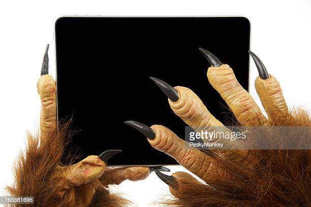 Scary Claw Monster Hands Use Digital Tablet Computer