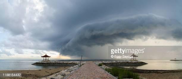 scary cloud on the beach panorama - seascape stock-fotos und bilder