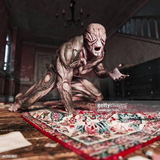 scary creature crawling on floor of ruined house - monster stock pictures, royalty-free photos & images