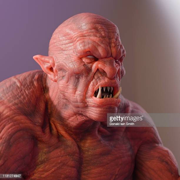 scary creature with fangs and pink skin - troll stock photos and pictures