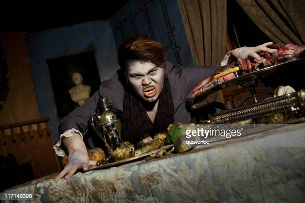 Demon with Pointy Teeth in Bloody Haunted House Dining Room