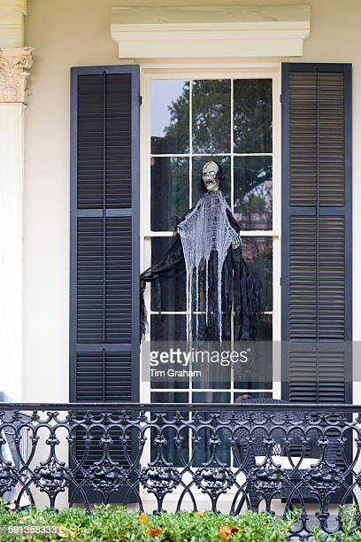 Scary Halloween voodoo skeleton ghost character at mansion house in the Garden District of New Orleans Louisiana USA
