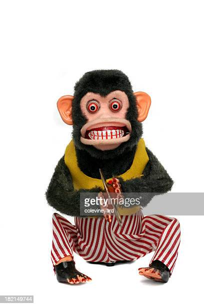 Scary looking vintage monkey in clothes playing cymbals
