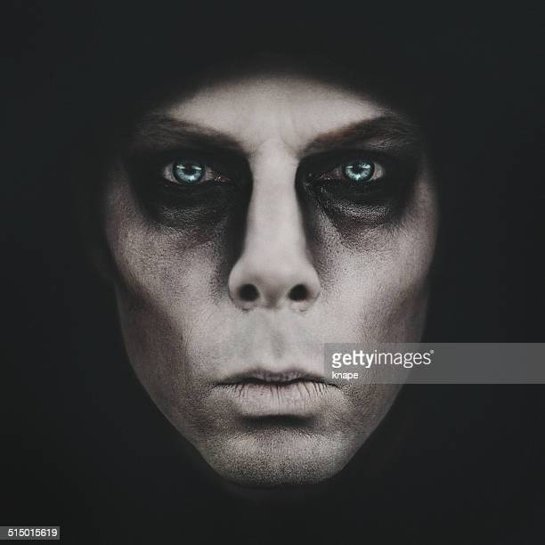 scary man coming out of the dark - zombie makeup stock photos and pictures