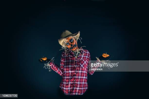scary pumpkin scarecrow halloween costume - scarecrow faces stock photos and pictures