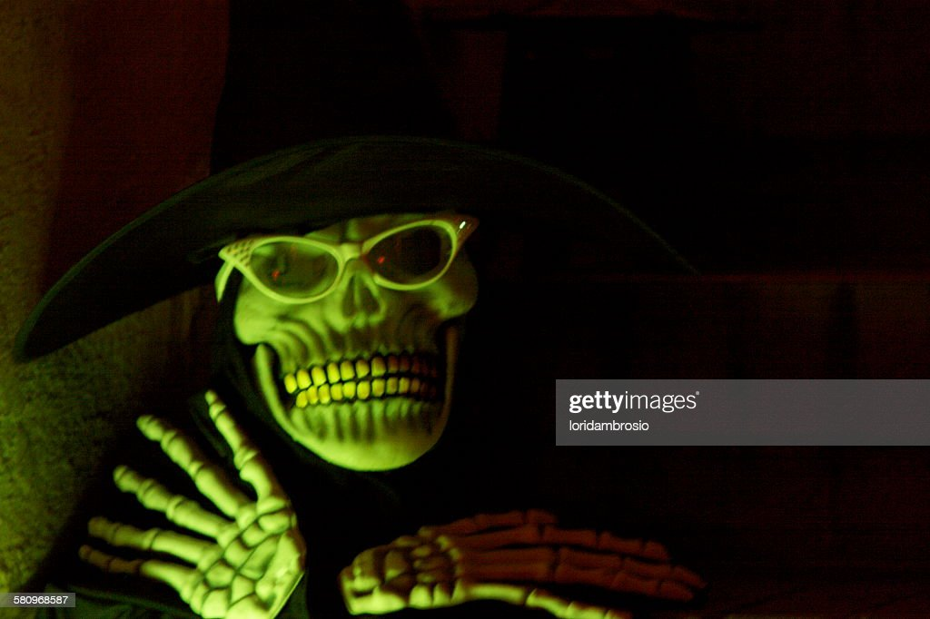 Scary skeletal witch face and hands : Stock Photo