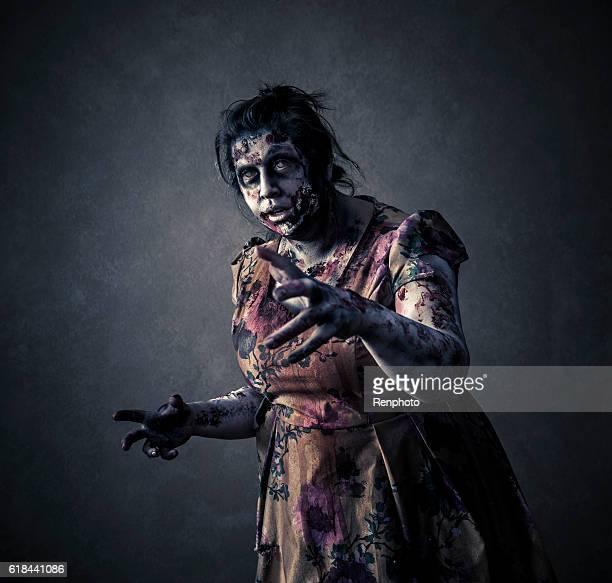 scary zombie sobre fondo negro - zombie fotografías e imágenes de stock