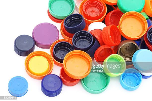 Scattered colorful plastic caps isolated in white