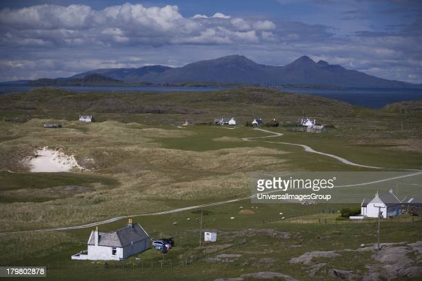 Scattered community at Sanna Bay, with the islands of Muck and Rum in view, Ardnamurchan Point, West Highlands, Scotland, United Kingdom.