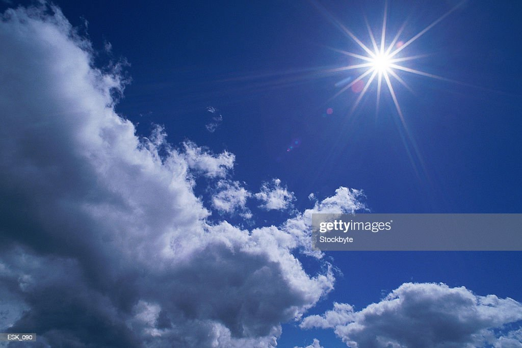 Scattered cumulus clouds and bright sun : Stock Photo