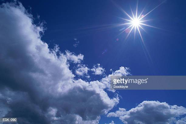 Scattered cumulus clouds and bright sun