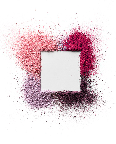 Scattered eyeshadow and blush for the face in the form of a square frame with space for text. Isolated on white background. 1070100808
