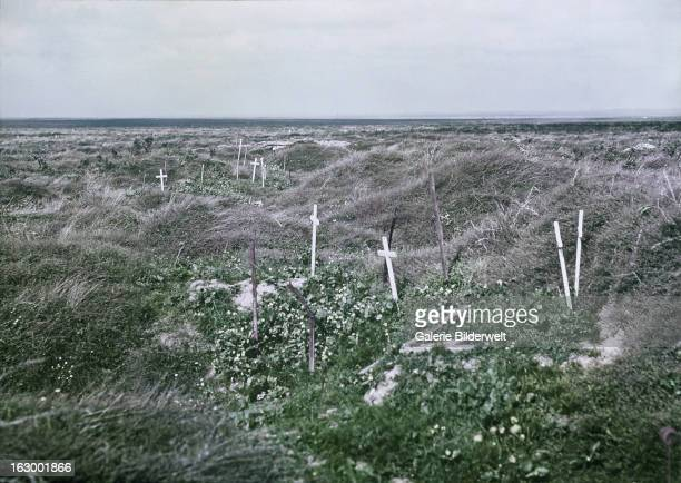 Scattered graves marked by simple white crosses on the old Somme battlefields in France during World War I September 1917 Western Front France Colour...