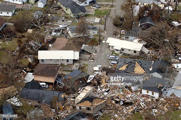Scattered homes and debris litter this neighborhood hit hard by Hurricane Katrina September 9 2005 in Gulfport Mississippi Damage from the storm is...