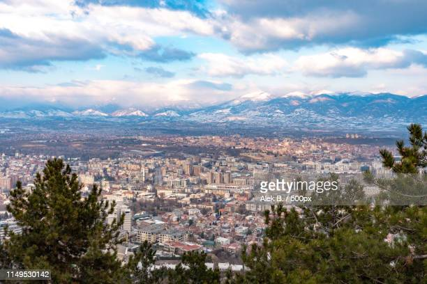 scattered light over the city and the mountains - skopje stock pictures, royalty-free photos & images
