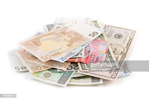 scattered pile of various banknotes isolated on white