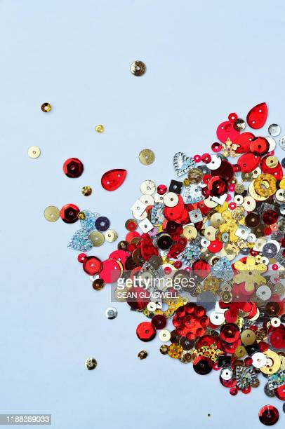 scattered sequins - sequin stock pictures, royalty-free photos & images