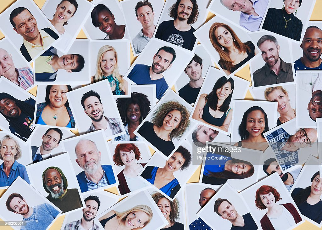 Scattering of printed portraits : Stock Photo