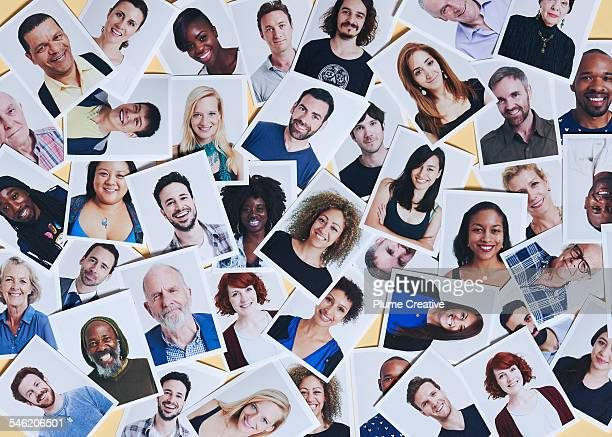 scattering of printed portraits - multiracial group stock pictures, royalty-free photos & images