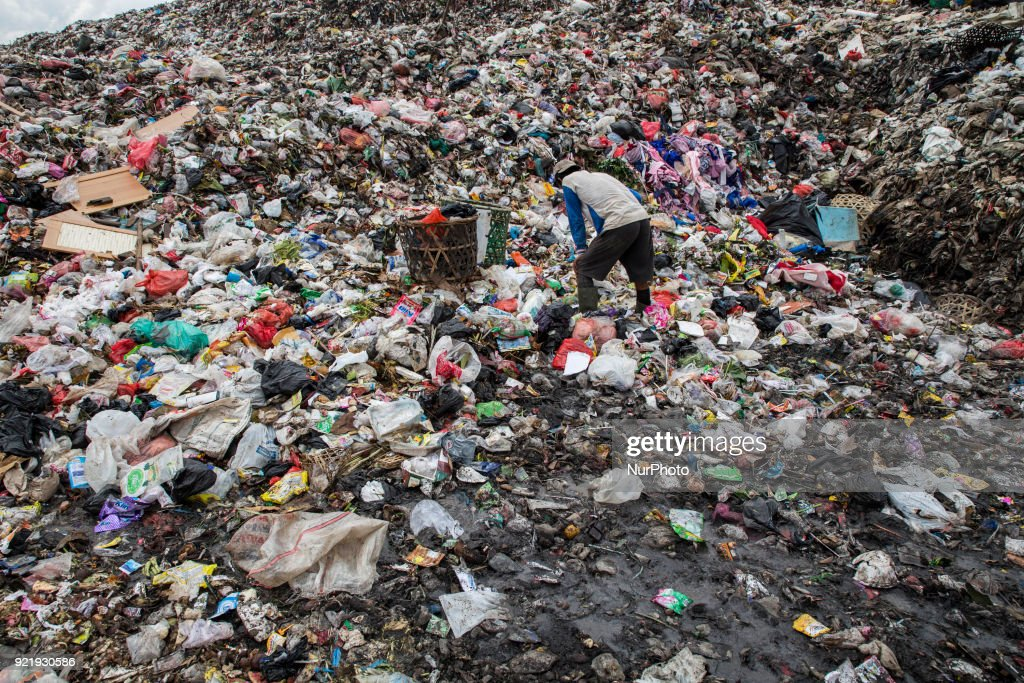 Scavengers finding garbages that can be reused at the waste management location in Serpong, Bante, Indonesia on 21 February 2018. Cipeucang-South Tangerang wast land fill with total of area 1,7 hectare received total of 250 Tons garbage every day. Under the chief of operator Mr. PATAIN SETIAWAN the garbage management running well, the place also produce metan gas that can be used for oever 20 houses near the area for cooking. Waste management in Indonesia is very critical that need serious action to take care.