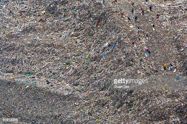 Scavengers on huge garbage landfill