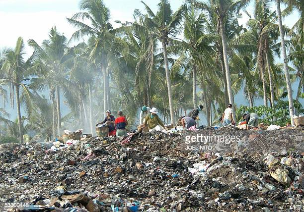 STORY PHILIPPINESTOURISMENVIRONMENTBORACAY Scavengers sift through the piles of garbage that have been dumped on a hillside in the central Philippine...