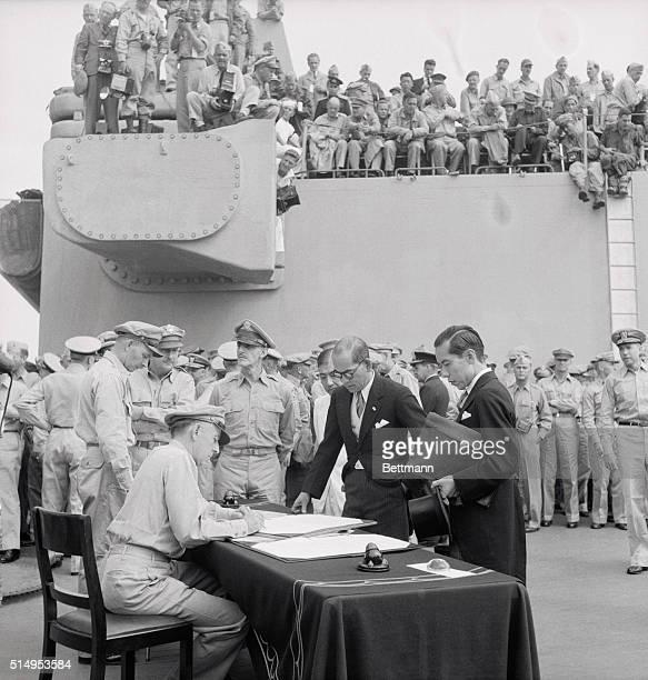 Scene Aboard USS Missouri Signing Surrender Jap delegates discuss surrender document with Lt Gen Richard Sutherland aboard USS Missouri
