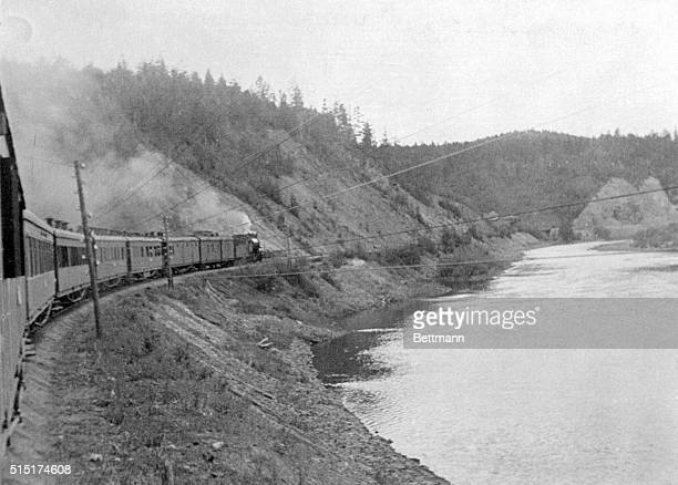 A scene along a forestsurrounded stream in Siberia as the crack TransSiberian express speeds eastward toward Vladivostok800 miles from Moscow The...